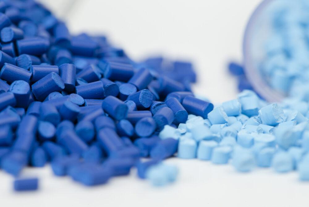 Light blue and dark blue polymer pellets