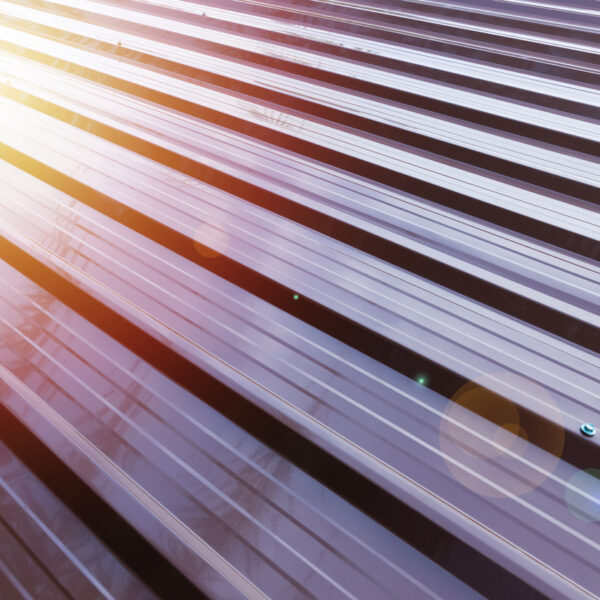 Corrugated metal roof with sun reflection