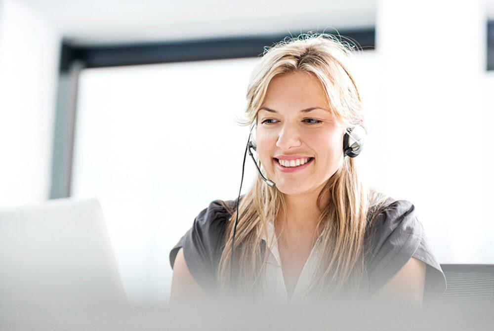 Female call centre agent smiling