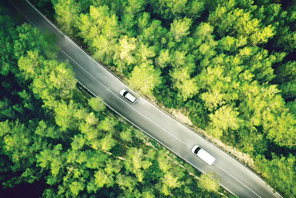 Arial view of quiet windy road in the countryside
