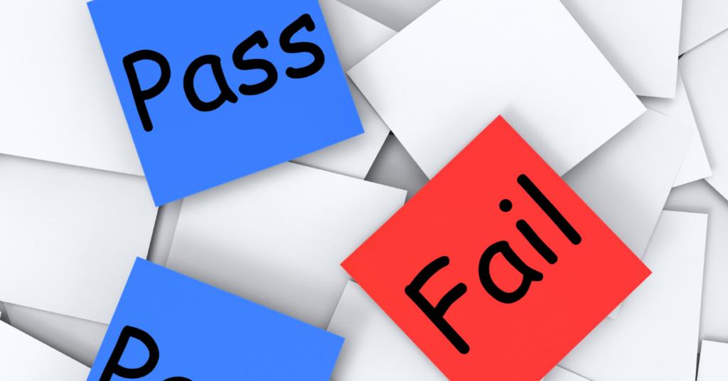 adhesive post-it notes saying pass or fail