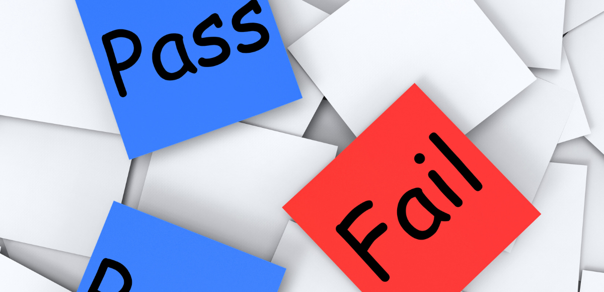 adhesive post-it notes saying pass or fail